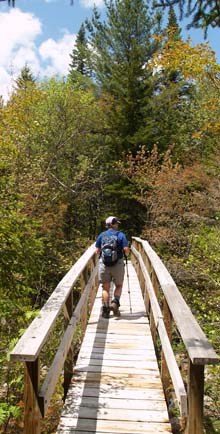 Cheryl crossing the bridge over the North Fork (photo by Webmaster)