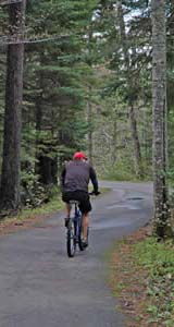 Cyclist along the Franconia Notch bike path (photo by Ben Kimball)