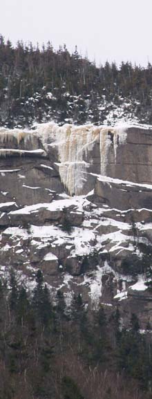 Icicles on East Osceola ledges as seen from lower Greeley Pond (photo by Webmaster)