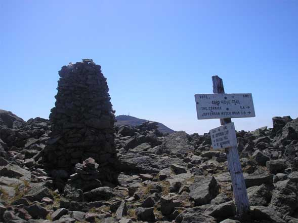 Cairn on Mount Jefferson's summit with Mount Washington visible in the background (photo by Kathy Veilleux)