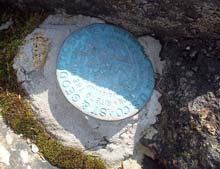Benchmark on Owl's Head (photo by Alex Clogston)