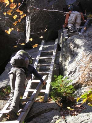 Descending the ladders below Mount Morgan's summit (photo by Mike Dickerman)