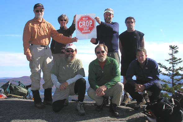 Hikers atop Mount Morgan. Bottom row from left are: Mike Dickerman, Roger Doucette and Jim Doucette. Top row: Thom Davis, Candace Morrison, Steve Smith and Steve Martin. (photo by Mike Dickerman)