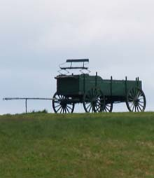 View up to the wagon from the gravel road (photo by Webmaster)