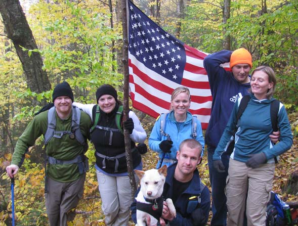 Hiking group with the flag at the crash site (photo by Karl Searl)